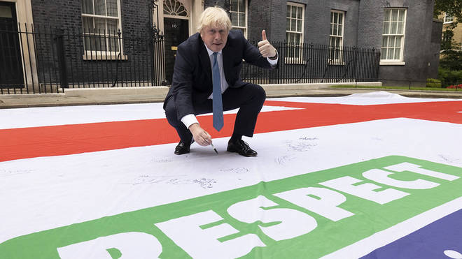 Boris Johnson appeared to sign the giant England flag