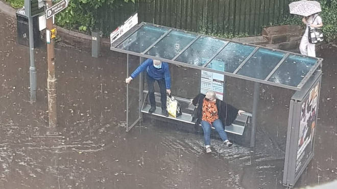 A couple were caught out in the rain