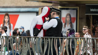A police officer speaks to an England fan ahead of the quarter-final with Ukraine last Sunday.