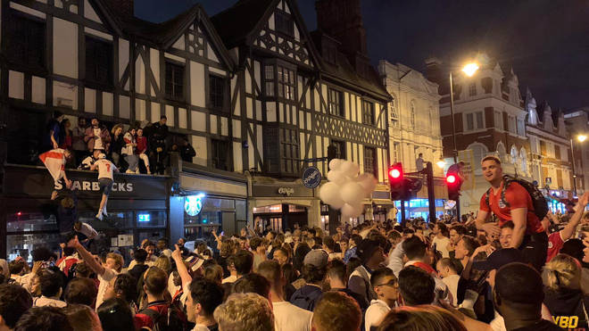 Fans celebrate in Clapham, London