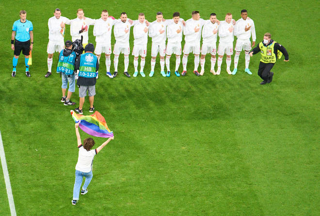 A person with a rainbow flag demonstrated when the Hungary national team played at Euro 2020