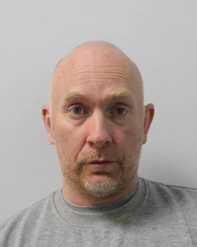 Custody photo of former Met Police officer Wayne Couzens