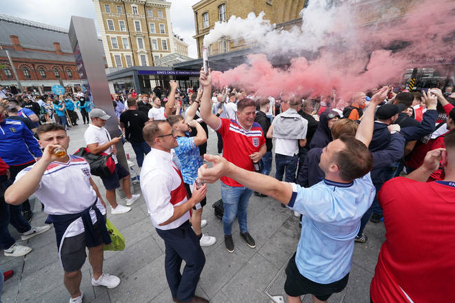 Supporters set off smoke flares and threw drinks as the party atmosphere grew.