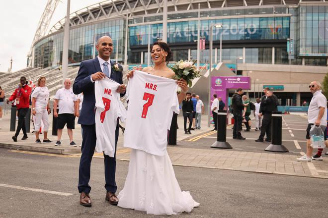 Newly married couple Amish (l) and Nimisha take wedding photos outside of Wembley Stadium.
