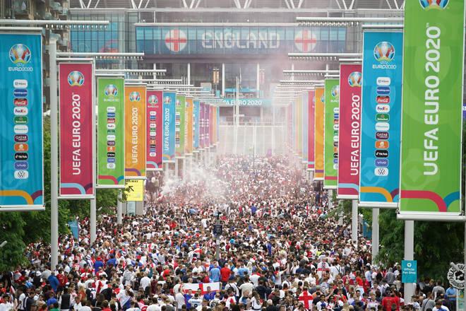 Huge crowds line Wembley Way ahead of the 8pm kickoff.