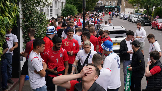 Crowds queued outside The Faltering Fullback in Finsbury Park hoping to find a seat to watch the game.