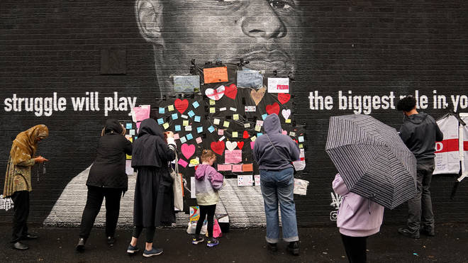 Fans gathered at the mural to share positive messages.