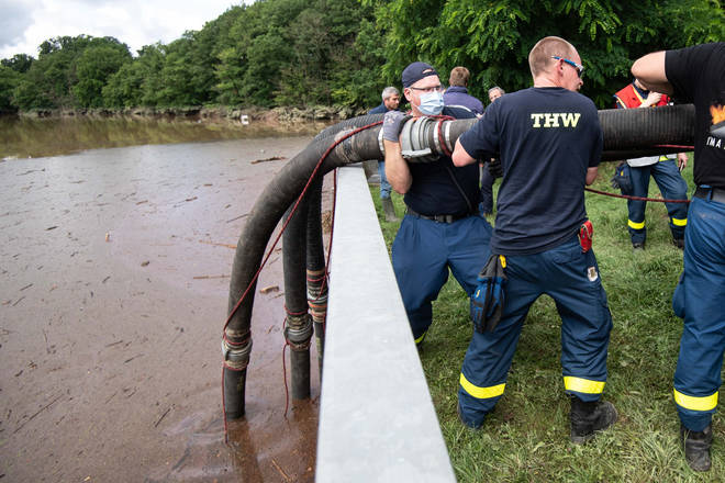 German Technical Relief workers have been pumping water out of the Steinbach dam, which is in danger of collapsing.