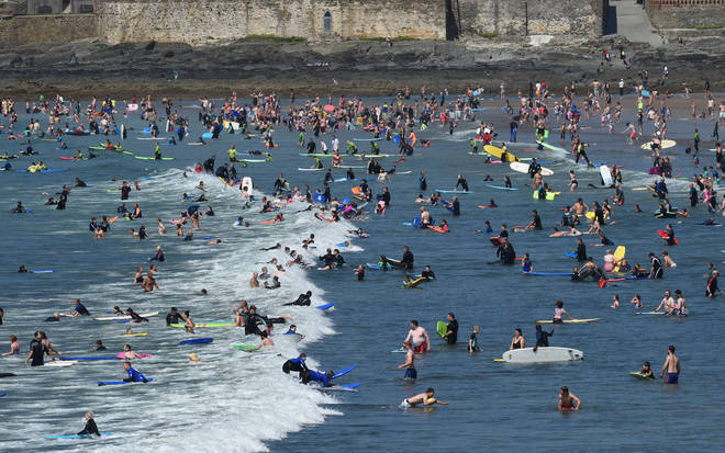 Croyde Bay in North Devon is very popular with holiday goers enjoying the sun.
