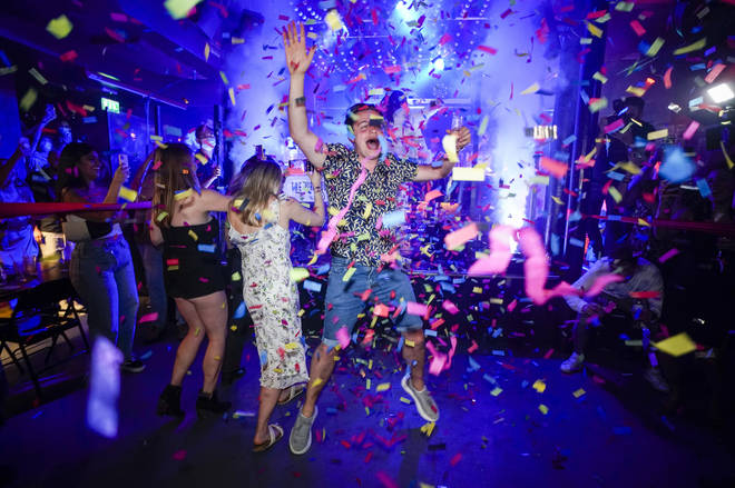 People celebrated the reopening of nightclubs at midnight.