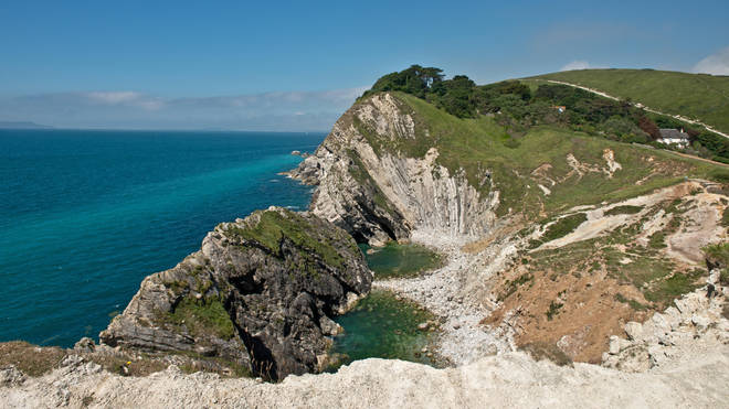 A man who fell from rocks at Stair Hole in Dorset was one of five heat-related deaths