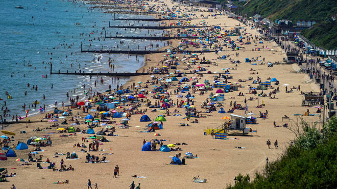 People enjoy the weather on Bournemouth beach in Dorset yesterday