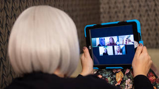 A group of women use the Zoom conferencing app