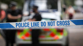 Three people have been arrested after two police officers were injured.