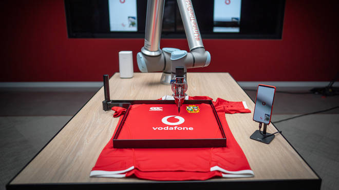 British & Irish Lions located in South Africa sign shirts of fans back in London, using 5G robotic arm