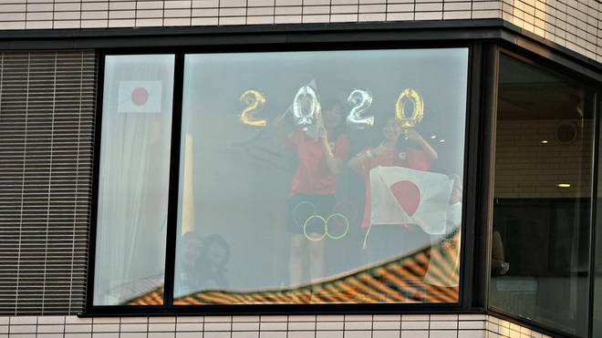 Residents of the adjacent apartment block tried to catch a glimpse of the ceremony