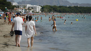 Holidaymakers enjoy the sun in Spain