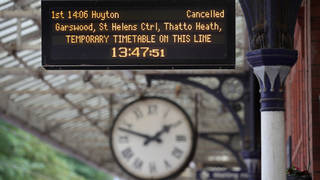 A railway station platform departure board