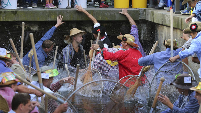 Fischertag participants competing to catch the biggest fish