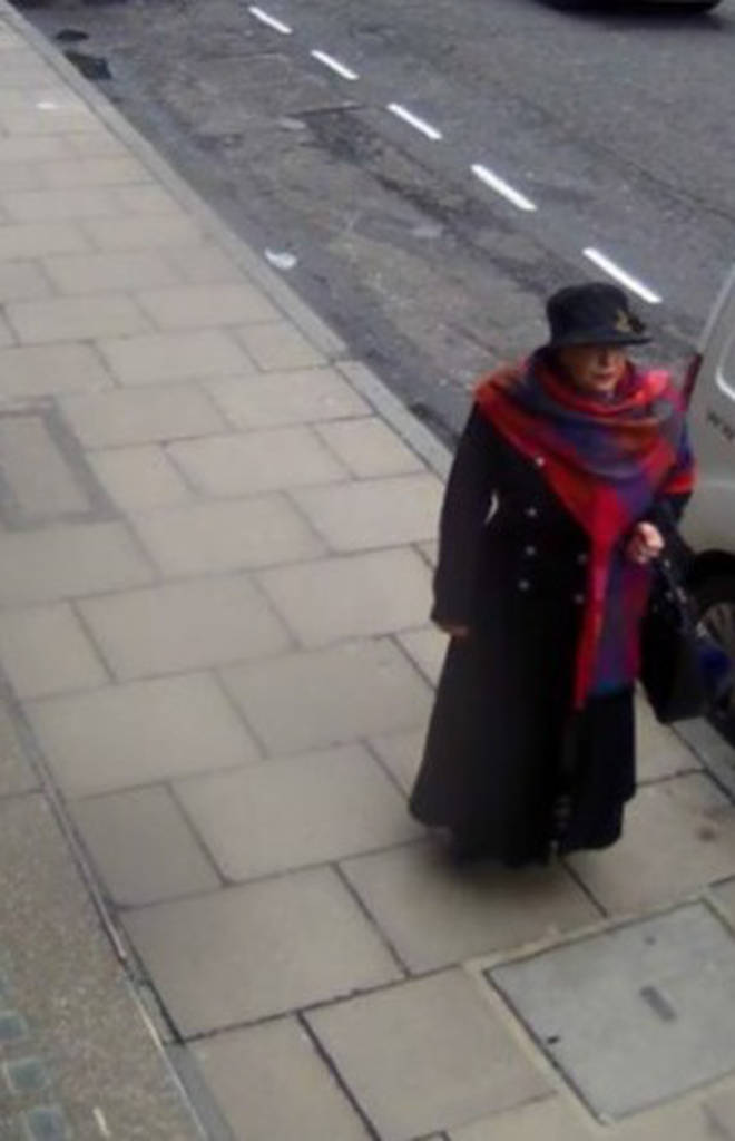 Lakatos disguised herself in a long dark coat, brimmed hat and long scarf
