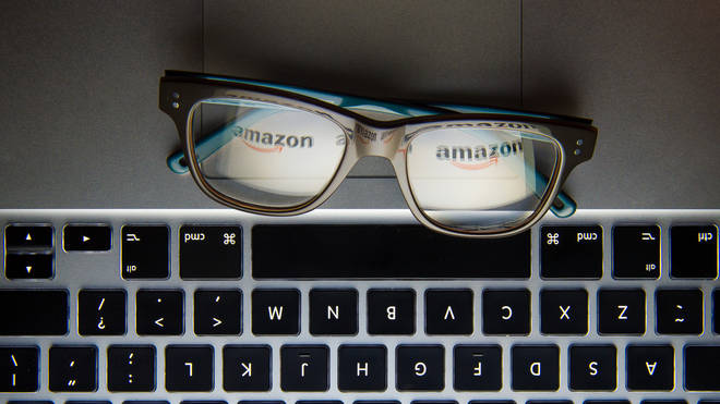 The logo of internet retailer Amazon reflected in a pair of glasses
