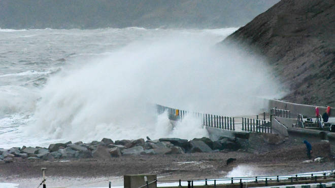 Heavy wind and rain is battering the UK's south coast