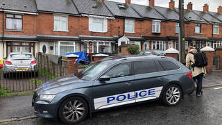 Police at the scene in Belfast where the baby died