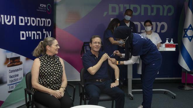 Israeli president Isaac Herzog receives his booster jab