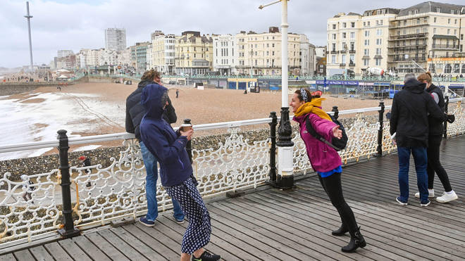 Strong winds weren't enough to stop some people enjoying Brighton pier