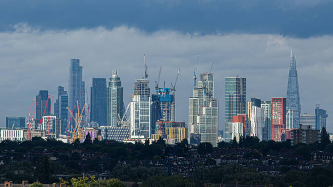 Ominous grey skies were pictured looming over London on Friday evening