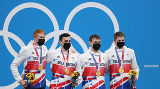 Team GB swimmers who have won gold medals are seen during the victory ceremony for the men's 4x200m freestyle relay final at Tokyo Aquatics Centre during the 2020 Summer Olympic Games.