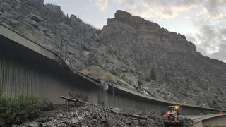 Equipment works to clear mud and debris from a mudslide on Interstate-70 through Glenwood Canyon, Colorado