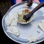 A young mother of five children shares a meal with her family at her Juba, South Sudan home (Adrienne Surprenant/PA)
