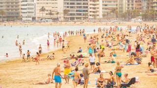 Tourist on the city beach in Las Palmas on Gran Canaria