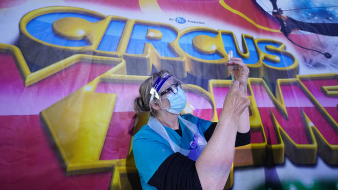 Dr Lisa Pickles, clinical lead for the Calderdale vaccination program, prepares a syringe at Circus Extreme