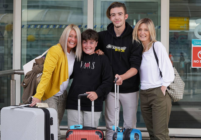 Michelle Bolger with her sons Taran and Kaie alongside her sister Elaine Burt at Glasgow Airport