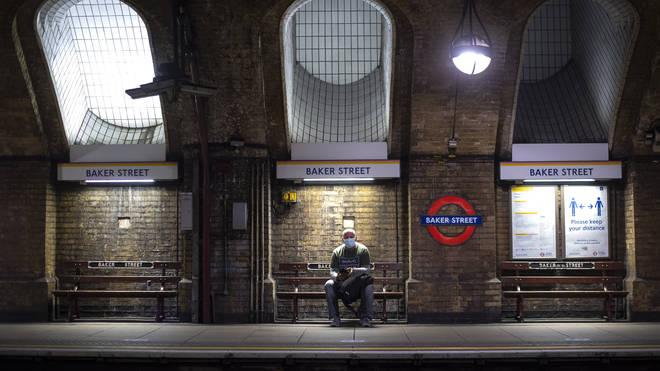 A man wearing a face mask in Baker Street Tube station in London (Victoria Jones/PA)