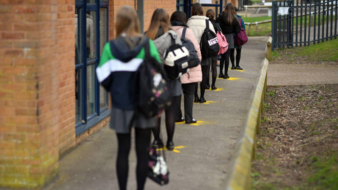 Pupils queuing to take a lateral flow test at Archway School in Stroud in Gloucestershire.
