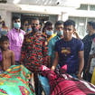 People gather around bodies of victims after lightning killed more than a dozen people in Bangladesh