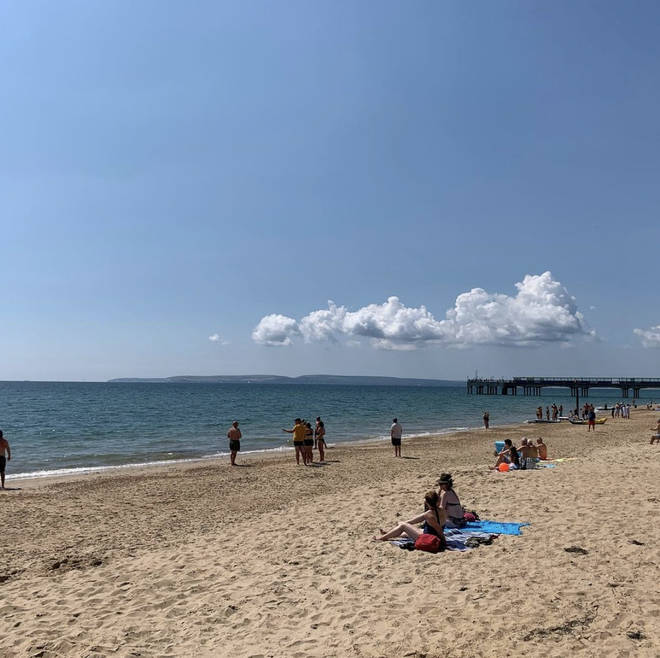 The beach at Boscombe after the sea was evacuated following a possible 'shark sighting'