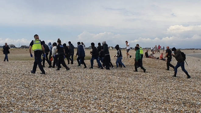 A group of migrants pictured yesterday landing near Dungeness power station