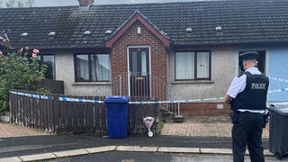 Emergency services at the scene in Dungannon, Co Tyrone, where a two-year-old who was found injured was rushed to hospital and later died.