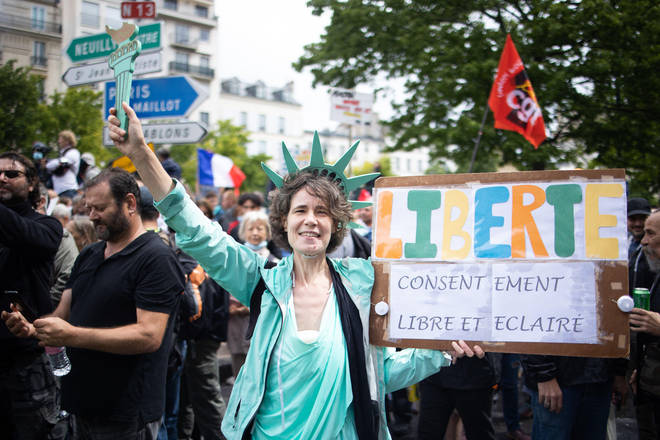 Protester wears a Statue of Liberty costume, during a national day of protest against the compulsory Covid-19 vaccination for certain workers and the mandatory use of the health pass called for by the French government in Paris