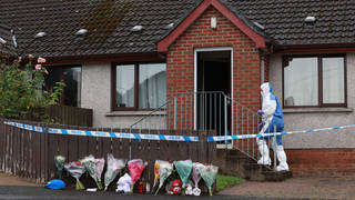 Forensics officers at the scene in Dungannon, Co Tyrone, where a two-year-old who was found injured on Friday afternoon was rushed to hospital and later died.