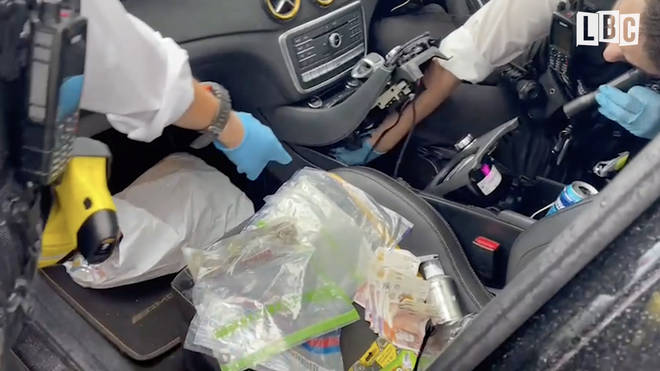 Police reveal the hidden cache of drugs and money in the car