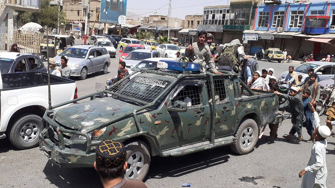 Taliban militants seen driving through Kandahar after taking over the city