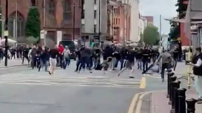 Dozens of men could be seen brawling on a street ahead of the game