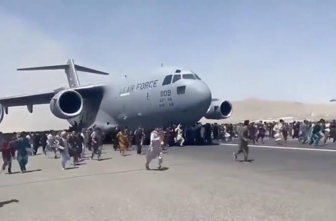 People desperately run alongside US Air Force plane in bid to leave Afghanistan