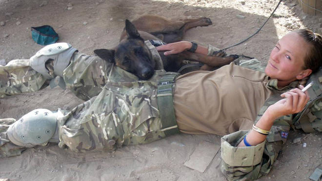 The Army dog relaxing with a soldier in Afghanistana
