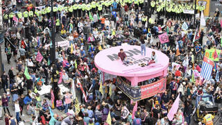 Extinction Rebellion protesters block streets in central London
